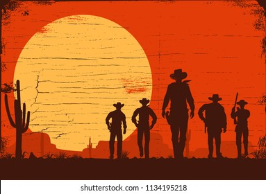 Silhouette of five cowboys walking forward on a wooden board