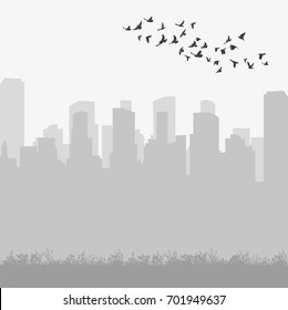 silhouette of flying birds on a gray city background