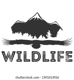 The silhouette of a flying eagle with open wings. Bird on a background of a forest, a sun and mountains. Wild nature and wildlife logo template. Bottom text, inscription.