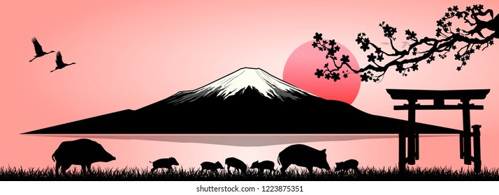 Silhouette Fuji mountain at sunset. Family of wild boars on the background of Mount Fuji.