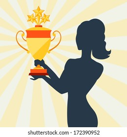 Silhouette of girl holding prize cup.