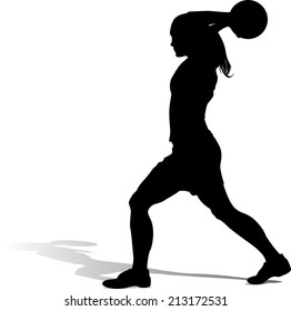 Silhouette of a girl with a soccer throw in.