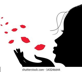Silhouette of a girl who sends an air kiss