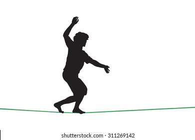 Silhouette of a guy walking on tightrope