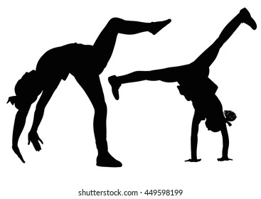 Silhouette gymnast girls standing on the hands