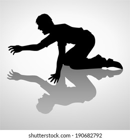 Silhouette illustration of a man crawling