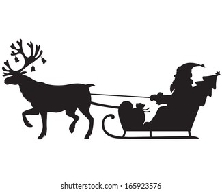 Silhouette image of Santa Claus riding a sleigh with reindeer
