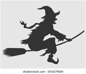 silhouette image of witch woman
