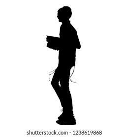 Silhouette of a Jew with a book of Torah. Young Hasid. Orthodoxy is a Jew. Isolated vector illustration. Isolated background. Black on white.