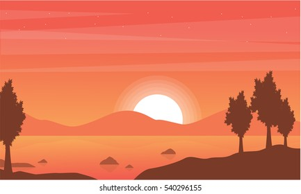 Silhouette of lake with mountain backgrounds