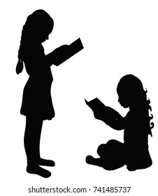 silhouette little girl reading a book