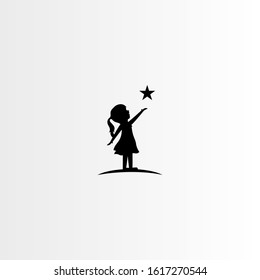 silhouette of a little girl with star - vector illustration