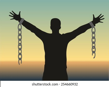 Silhouette of a man with broken chains
