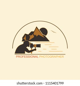 Silhouette of a man with a camera on the background of mountains and the sea. Emblem for professional photographers on a white background.