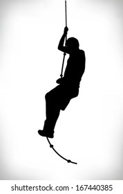 silhouette of a man climbing a rope