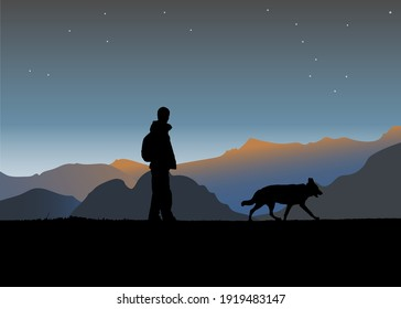Silhouette of a man and a dog walking on a cliffin the mountains at sunset.