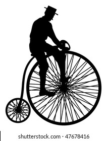 silhouette of man on an antique bicycle