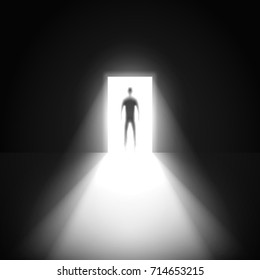 Silhouette of man and open door in a dark room with light going through it.