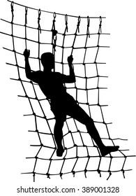 silhouette of a man overcomes obstacles in the rope park