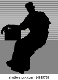 silhouette of man sitting