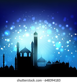 Silhouette of mosques against bokeh lights night sky