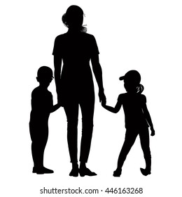 Silhouette of mother holding hands his son and daughter