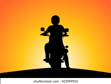 Silhouette of motorcyclists on nature at sunset.