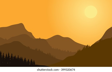 Silhouette of mountain and forest at sunset