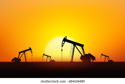 Silhouette Oil pumps at oil field with sunset sky background