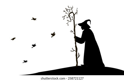silhouette of  old enchantress with tree stick and flying sparrow on white background
