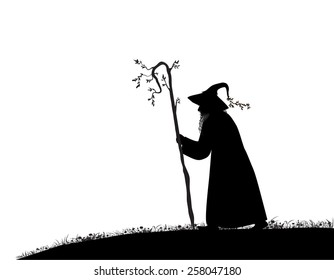 silhouette of  old wizard with tree stick on white background