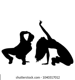 silhouette of people dancing