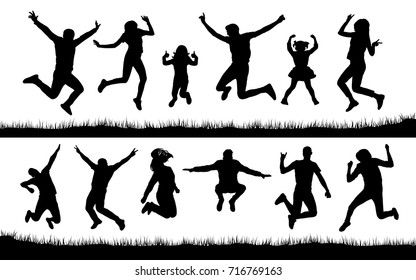 Silhouette of people jumping on the grass