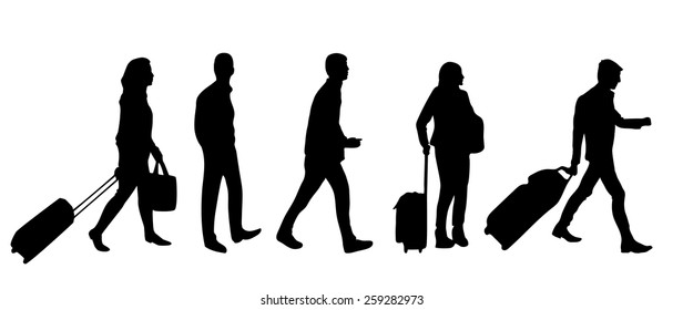 Silhouette of people with luggage walking in airport