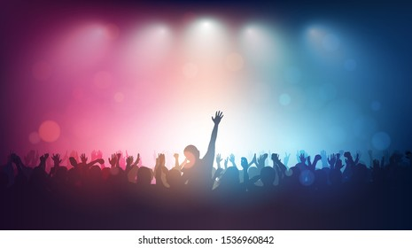 Silhouette of people raise hand up in music concert with red and blue color spotlight on stage background
