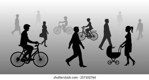 Silhouette of people walking and cycling