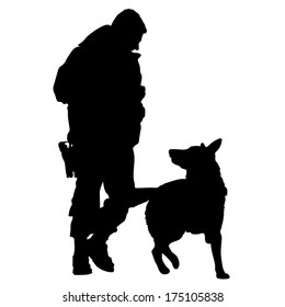 Silhouette of a police officer training with his dog partner