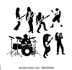 silhouette of rock and roll musicians