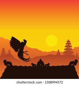 Silhouette of a rooster on the roof on Bali Island. Rooster soars above the roof during sunset.