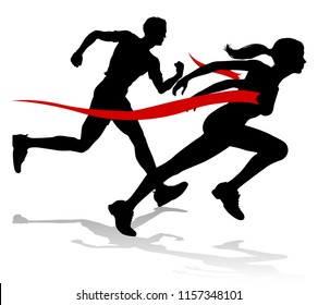 Silhouette runners in a race track and field event crossing the finish line