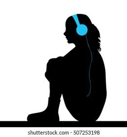 Silhouette of sad girl listening music