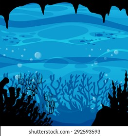 Silhouette scene from underwater with coral reef