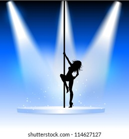 Silhouette of a sexy pole dancer on a podium under spotlights