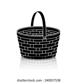 silhouette straw basket with a handle and reflection on white background