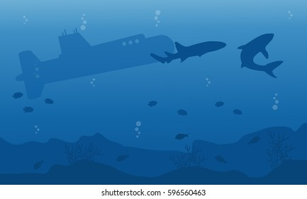Silhouette of submarine and shark ob blue sea