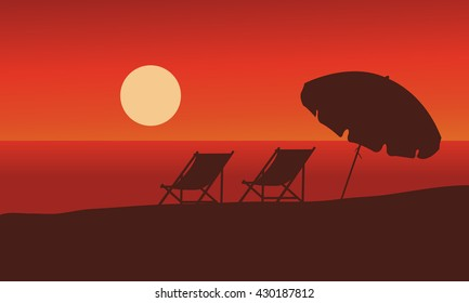Silhouette of summer beach at sunset with red backgrounds