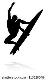 Silhouette of a surfer surfing the waves on his surfboard