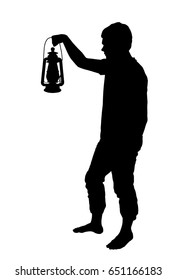 Silhouette of a teenage boy holding up lantern