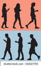 Silhouette of Teens Texting While They Walk