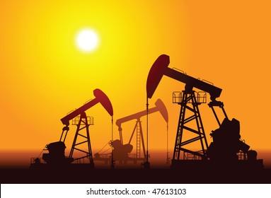 Silhouette of three oil rigs